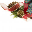 Stock Photo: Christmas Present with Ribbon, Pine Cones and Pine Branches on W
