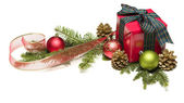 Christmas Present with Ribbon, Pine Cones and Ornaments — Stock Photo
