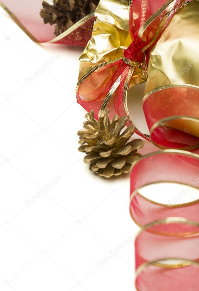 Christmas Present with Ribbon and Pine Cones on a White Background. — Stock Photo #16327881