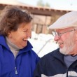 Happy Senior Adult Couple Bundled Up Outdoors — Stock Photo #16733659