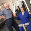 Senior Adult Couple Working Out Together in Gym — Stock Photo #16734345