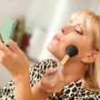 Blonde Woman Applying Her Makeup - Stock Photo