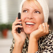 Attractive Caucasian Woman Talking on Cell Phone - Stock Photo