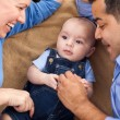 Mixed Race Family Playing on the Blanket — Stock Photo