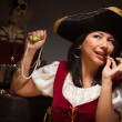 Dramatic Female Pirate Biting Coin — Stock Photo #16736329
