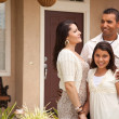 Stock Photo: Small Happy Hispanic Family in Front of Their Home