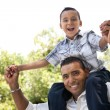 Hispanic Father and Son Having Fun in the Park - Stock Photo