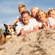 Happy Caucasian Family Portrait at the Beach - Stock Photo