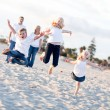 Happy Sibling Children Jumping for Joy - Stock Photo