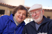 Happy Senior Adult Couple Bundled Up Outdoors — Stock Photo