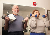 Senior Adult Couple Working Out in the Gym — Stock Photo