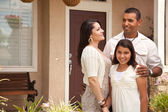 Small Happy Hispanic Family in Front of Their Home — Stock Photo