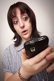 Stunned Brunette Woman Using Cell Phone — Stock Photo