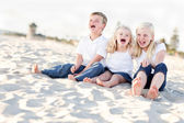 Cute Sibling Children Sitting at the Beach — Stock Photo