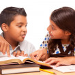 Hispanic Brother and Sister Having Fun Studying — Stock Photo #16745763