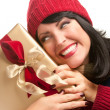 Happy Attractive Woman Holding Holiday Gift — Stock Photo #16740985