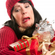Attractive Woman Fumbling with Her Holiday Gifts — Stock Photo #16741035