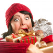 Attractive Woman Fumbling with Her Holiday Gifts — Stock Photo #16741085