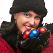 Attractive Woman Holding Christmas Ornaments - Stock Photo