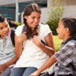 Hispanic Brothers and Sister Talking Ready for School — Stock Photo #16743815