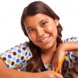 Stock Photo: Pretty Smiling Hispanic Girl Studying