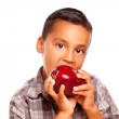 Adorable Hispanic Boy Eating a Large Red Apple — Stock Photo #16747489