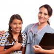 Pretty Hispanic Girl and Female Doctor Isolated - Stock Photo