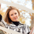 Pretty Young Woman Smiling in the Park with Picture Frame — Stock Photo