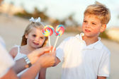 Cute Brother and Sister Picking out Lollipop — Stock Photo