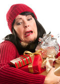 Attractive Woman Fumbling with Her Holiday Gifts — Stock Photo