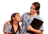 Pretty Hispanic Girl and Female Doctor Isolated — Stock Photo