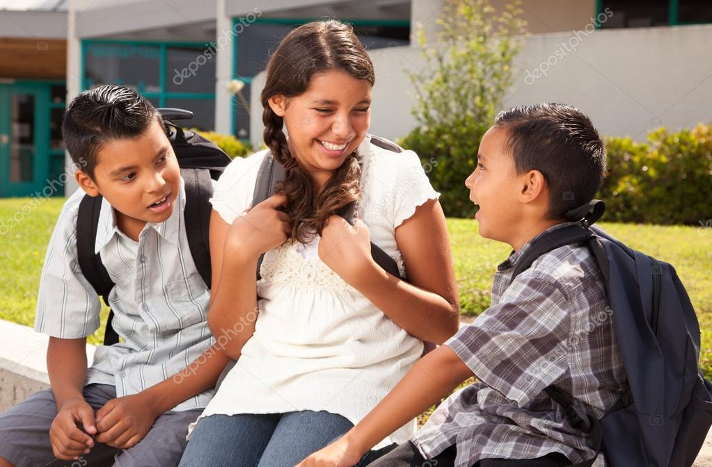 Cute Hispanic Brothers and Sister Talking Ready for School on Morning. — Stock Photo #16743815