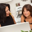 Hispanic Mother and Mixed Race Daughter on the Laptop — Stock Photo #16750723