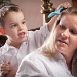 Cute Son Brushing His Mom — Stock Photo
