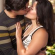 Attractive Hispanic Couple Kissing Outdoors — Stock Photo #16751305