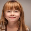 Fun Portrait of an Adorable Red Haired Girl on Grey — Stock Photo #16752419