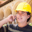 Handsome Hispanic Contractor on Phone with Hard Hat Outside — Stock Photo