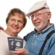 Happy Senior Couple with Passports and Bags on White - Стоковая фотография