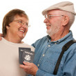 Happy Senior Couple with Passports and Bags on White — Stock Photo