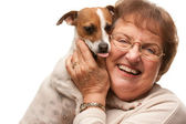 Happy Attractive Senior Woman with Puppy on White — Stock Photo