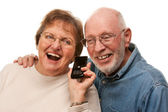 Happy Senior Couple Using Cell Phone on White — Stock Photo