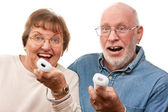 Happy Senior Couple Play Video Game with Remotes — Stock Photo