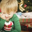 Young Grumpy Boy Sitting Near Christmas Tree — Stock Photo #16977789