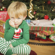 Young Grumpy Boy Sitting Near Christmas Tree — Stock fotografie