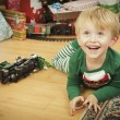 Young Boy Enjoying Christmas Morning Near The Tree — Stock Photo #16977825