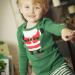 Young Boy Enjoying Christmas Morning Near The Tree — Stock Photo #16977829