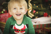 Young Boy Enjoying Christmas Morning Near The Tree — Stock Photo