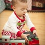 Infant Mixed Race Baby Enjoying Christmas Morning Near The Tree — Stock Photo #17126273