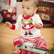 Infant Mixed Race Baby Enjoying Christmas Morning Near The Tree — Stock Photo #17126241