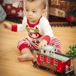 Infant Mixed Race Baby Enjoying Christmas Morning Near The Tree — Stock Photo #17126249